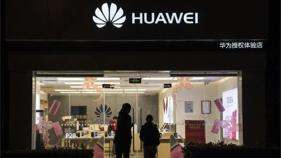 Customers entering a Huawei Technologies store on 29 January, 2019 in Beijing, China