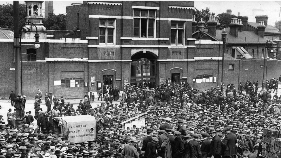 Workers congregate outside the Woolwich Arsenal during the strike of 1914
