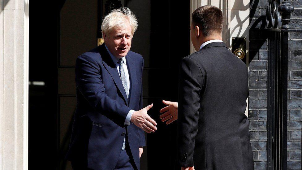 Boris Johnson shakes hands with Juri Ratas