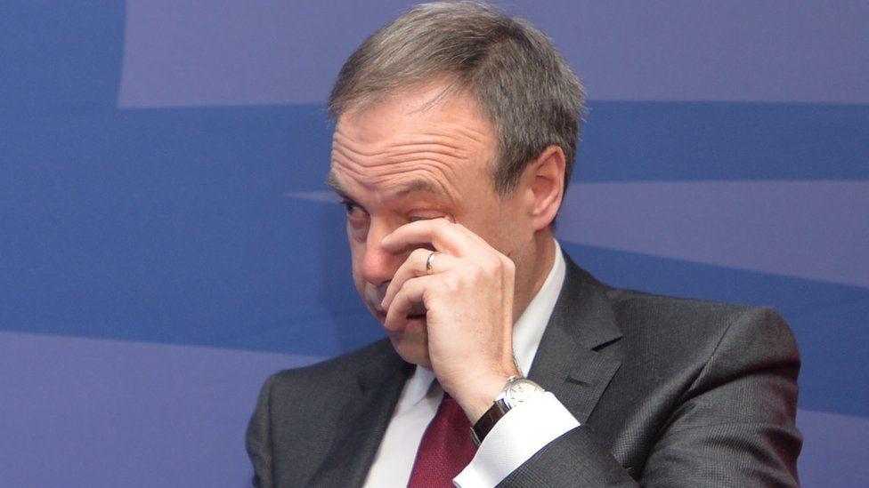 Nigel Dodds wipes his eyes