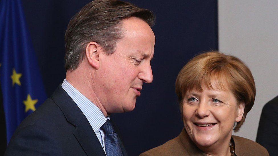British PM David Cameron and German Chancellor Angela Merkel talk.