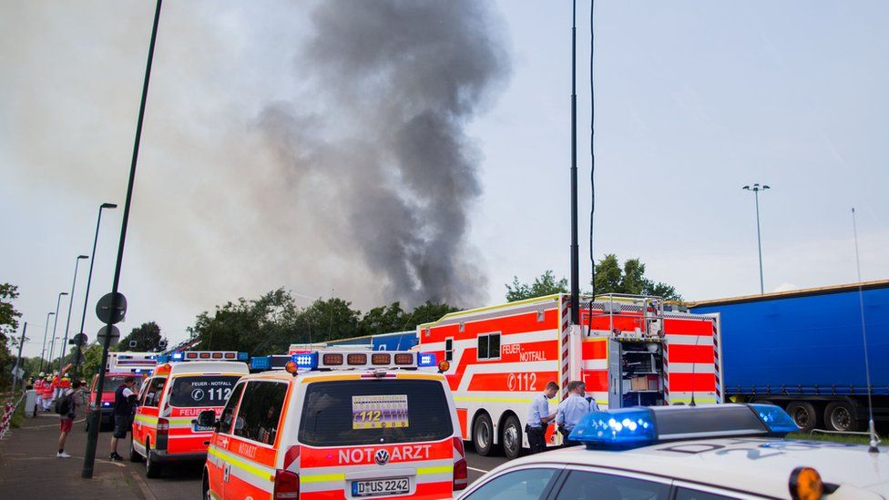 Emergency vehicles gathered at the convention centre where a fire broke out in the western city of Duesseldorf, Tuesday, 7 June 2016