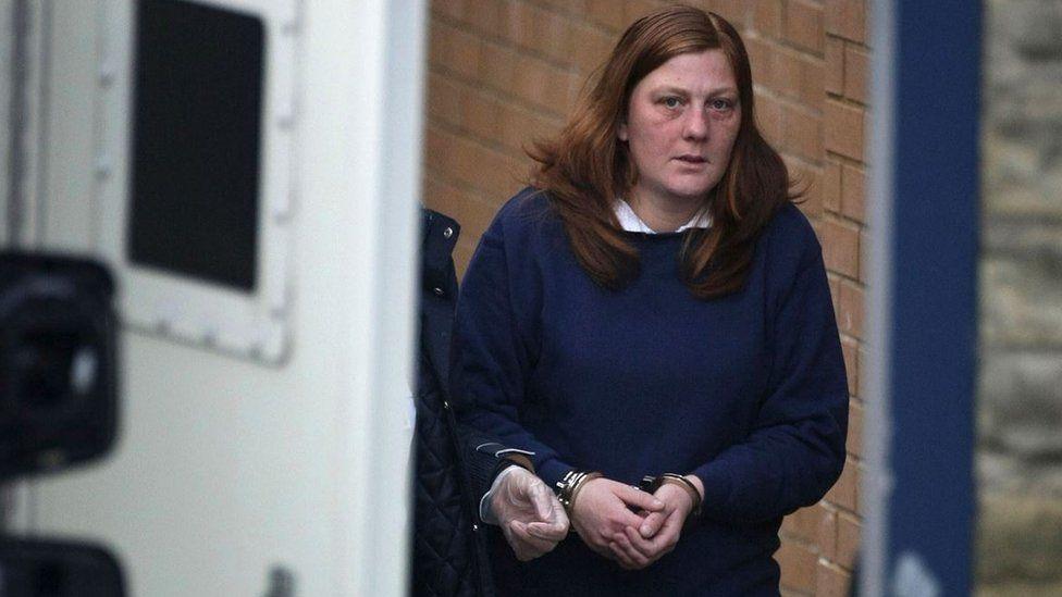 A handcuffed Karen Matthews after being charged