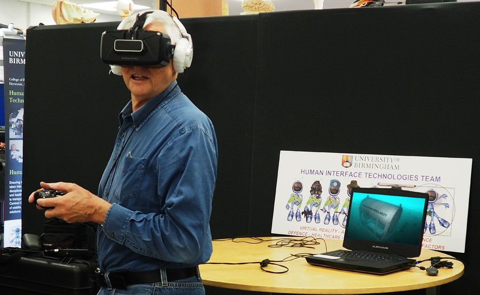 Irwin looks at a recreation of the Glaucus through a virtual reality headset