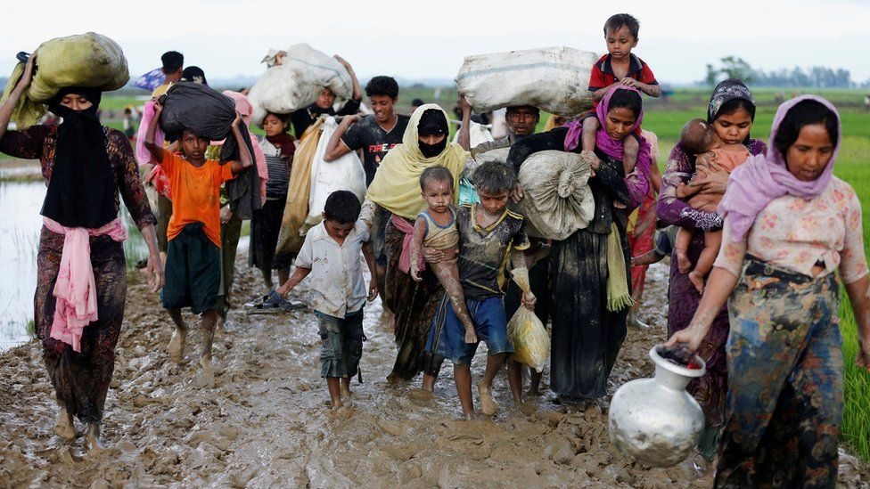 Rohingya refugees walk on the muddy road after travelling over the Bangladesh-Myanmar border, Teknaf, 2 Sept 2017