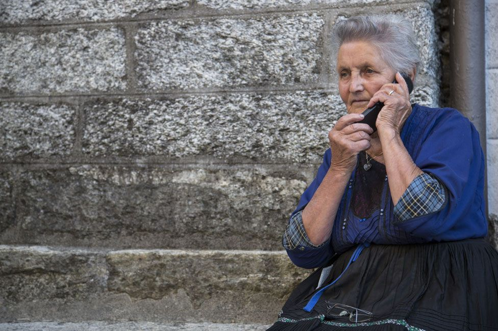 Woman on telephone, showing tartan cuffs