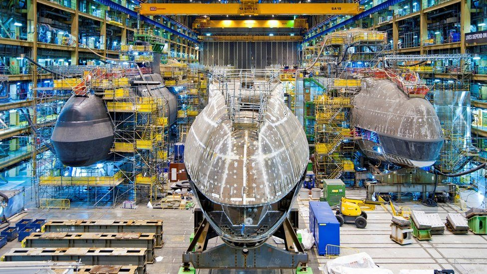 The forward end construction of the fifth Astute class submarine, Anson, lining up alongside her sisters, Artful and Audacious