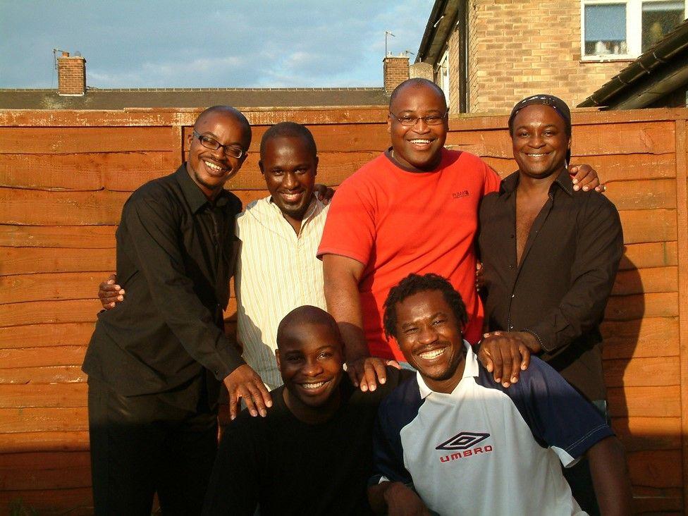 Tony Kofi with his brothers