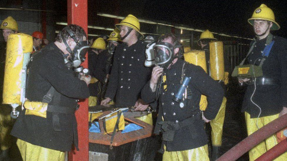 Firefighters outside King's Cross station on 18 November 1987