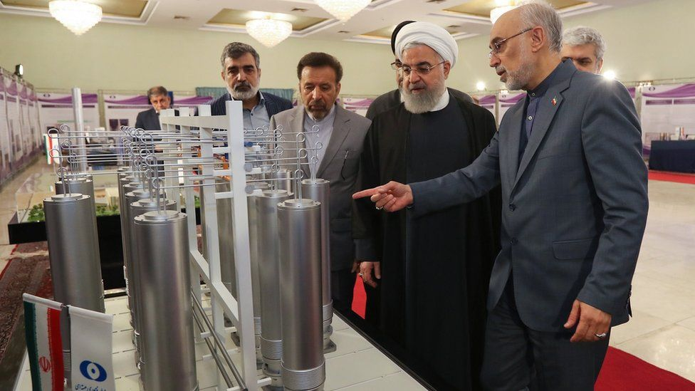 A handout file picture made available by Iran's presidency shows President Hassan Rouhani (C) and the head of the Atomic Energy Organisation of Iran, Ali Akbar Salehi (R), inspecting nuclear technology in Tehran, Iran (9 April 2019)