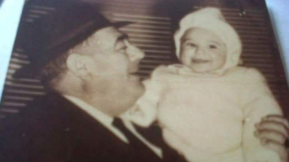 Ascension Lopez as a baby with her father