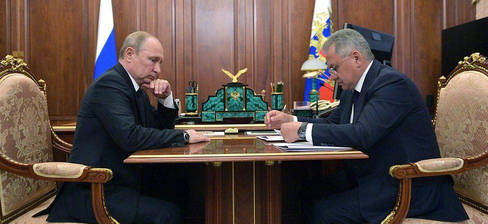 Russian President Vladimir Putin and Defence Minister Sergei Shoigu
