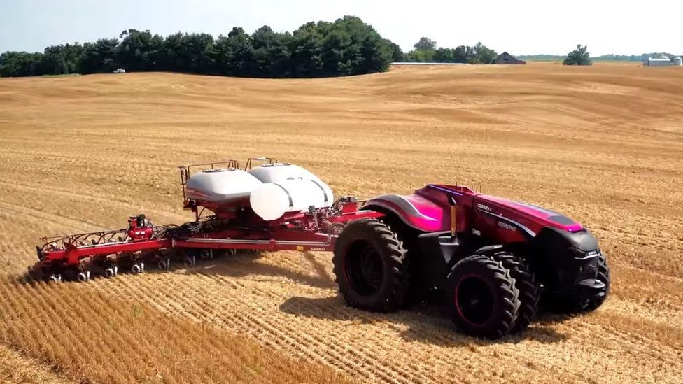 Driverless tractor tilling in field