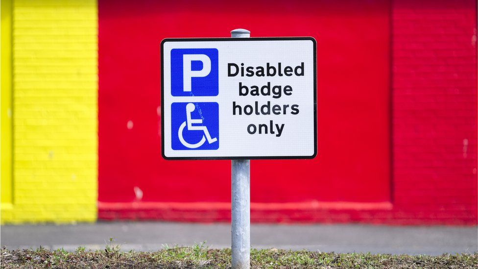 A sign reading 'disabled badge holders only'