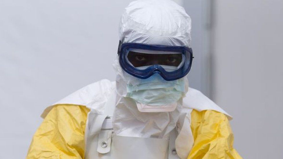 An Ebola worker in Guinea - archive