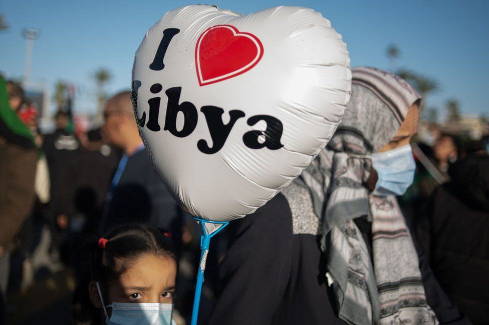 "A girl carries a balloon that reads ""I [heart] Libya"" in Tripoli, Libya - Wednesday 17 February 202"