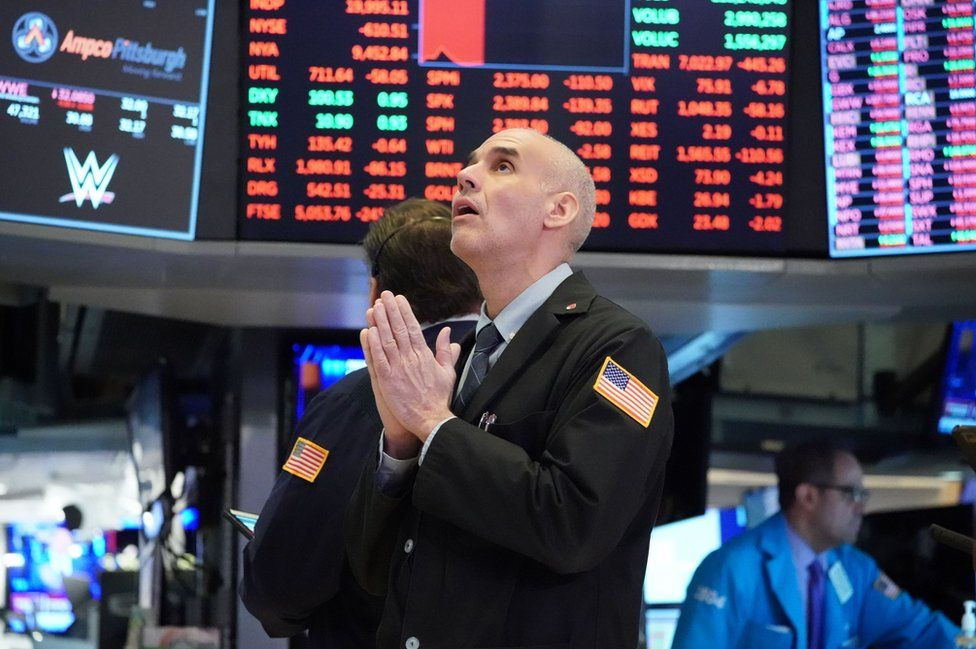 Traders work on the floor