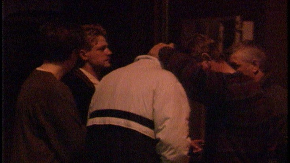 People gathered outside the bar in shock after the shooting