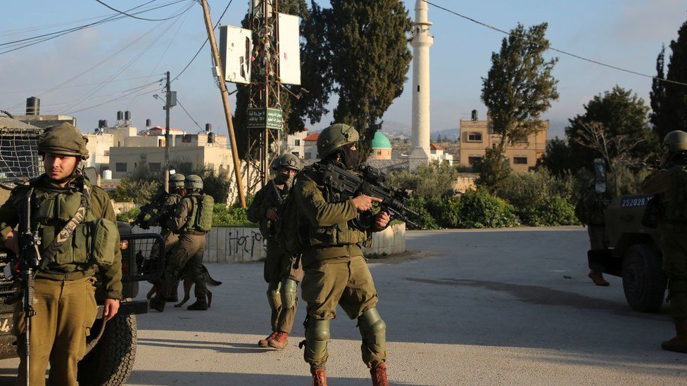 Israeli security forces patrol a street in the West Bank village of Salem on 18 March 2019