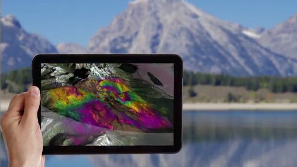 Tablet showing shortwave infrared image of mountain