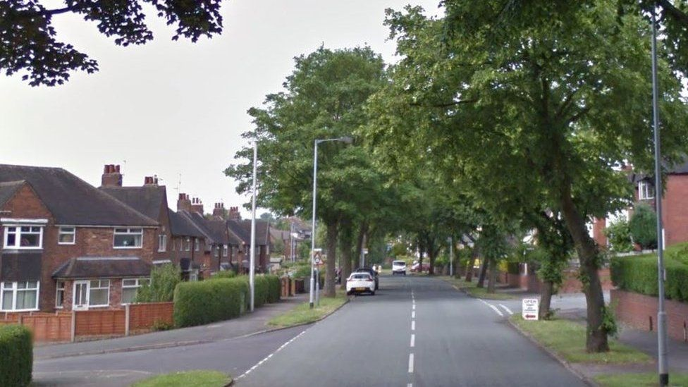 Hempstalls Lane at the junction with Beattie Avenue in Newcastle-under-Lyme, Staffordshire.