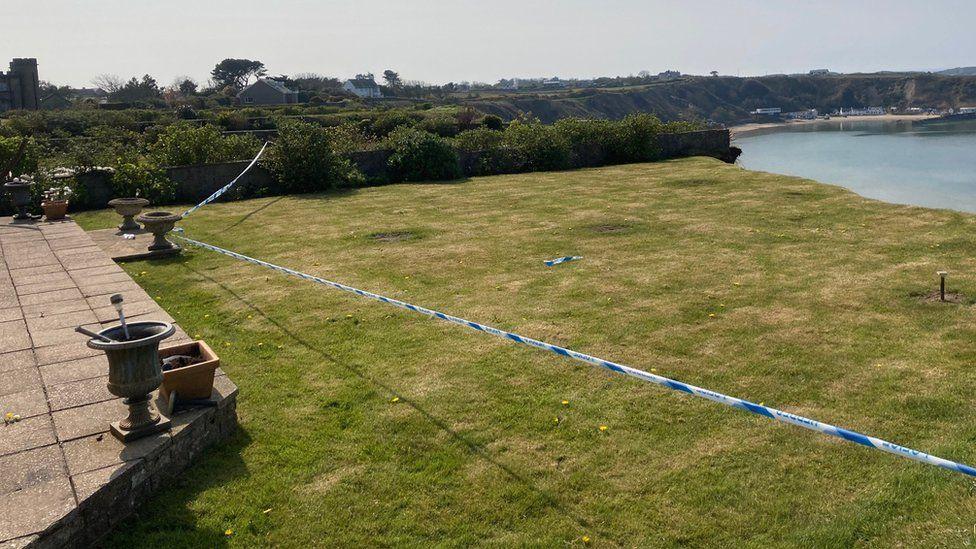 A garden that has partially fallen into the sea