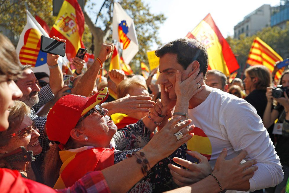Ciudadanos (Citizens) leader Albert Rivera (R) is greeted by supporters in Barcelona, 27 October