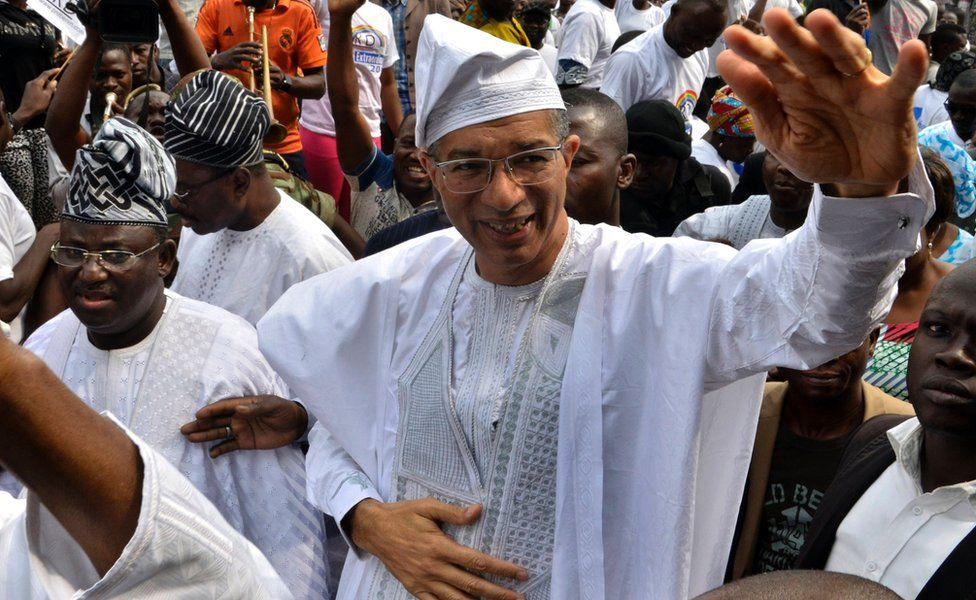 Benin's Prime Minister Lionel Zinsou, a French-Beninese investment banker, waves during a rally after being nominated to fly the party flag for the forthcoming presidential election in Cotonou, January 31, 2016