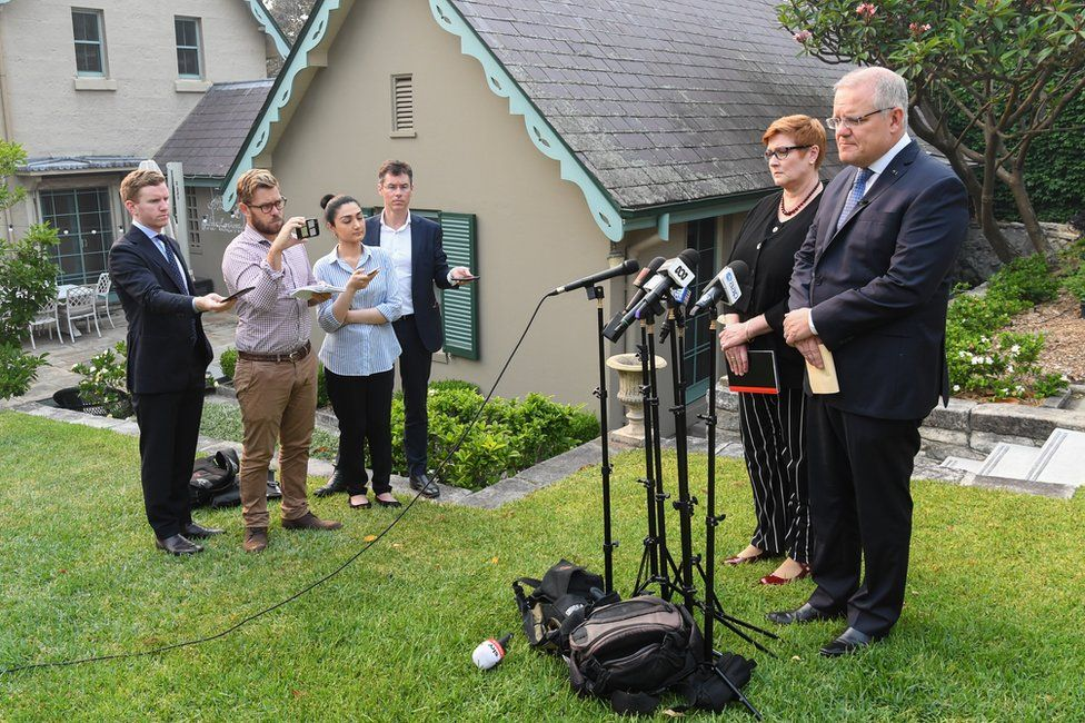 Australian Prime Minister Scott Morrison addresses the media with Foreign Minister Marise Payne