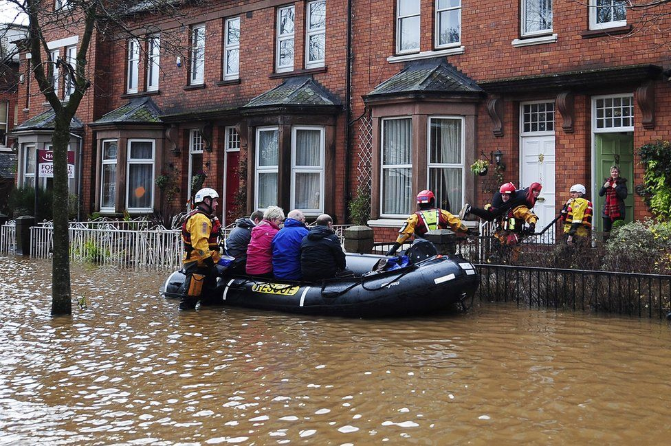 A dinghy crew rescue householders in Carlisle