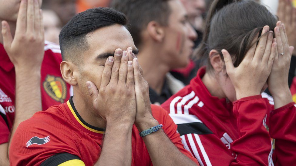 Belgian football fans react as they watch the World Cup semi-final match against France, 10 July 2018