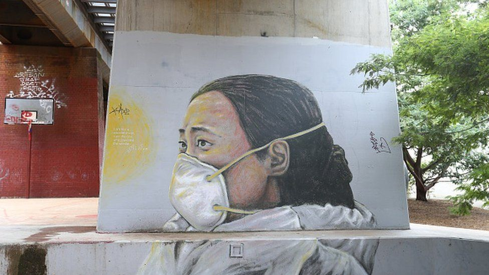 A mural of Ai Fen, one of the first doctors to raise the alarm on COVID-19