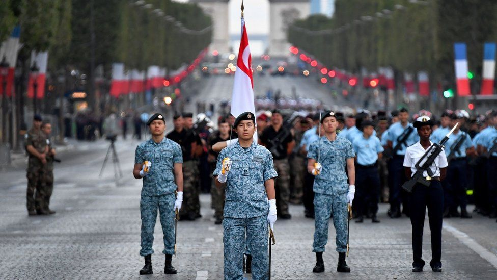 Singaporean troops parading in the boulevard