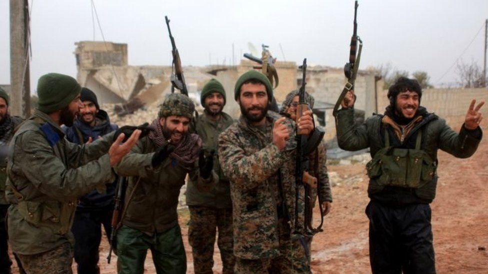 Syrian government soldiers celebrate after taking control of the village of Ratian, north of Aleppo. Photo: 6 February 2016