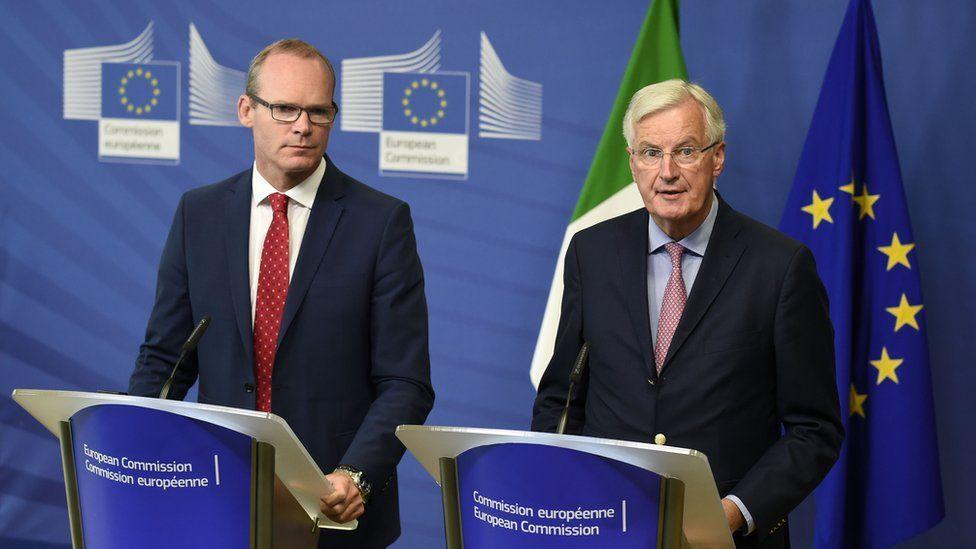 Irish Foreign Minister Simon Coveney and EU chief negotiator Michel Barnier