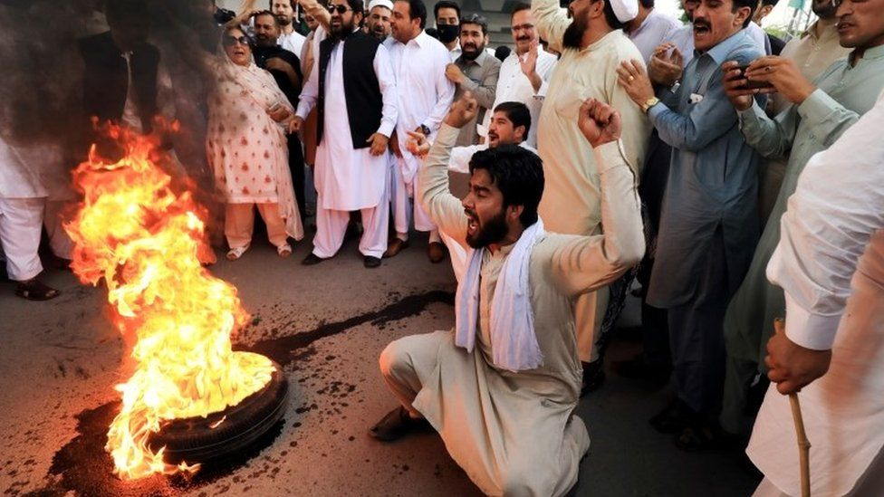 Supporters of the Pakistan Peoples Party protest the arrest of former president Asif Ali Zardari