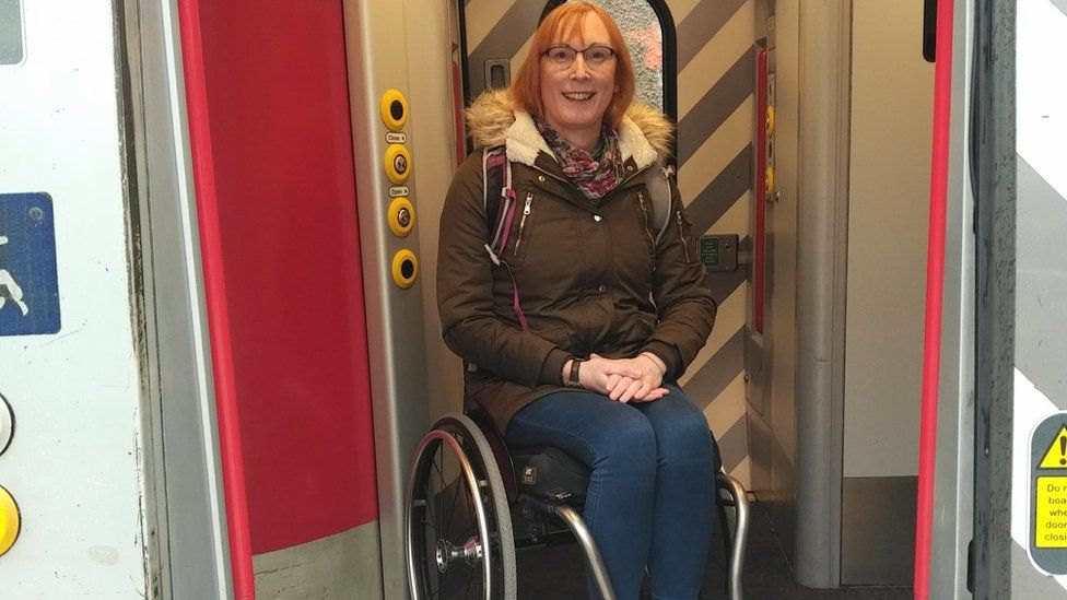 Wheelchair user Sarah Ward on a train