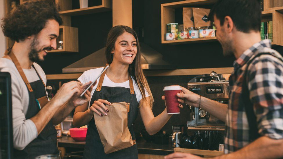 Staff serving coffee