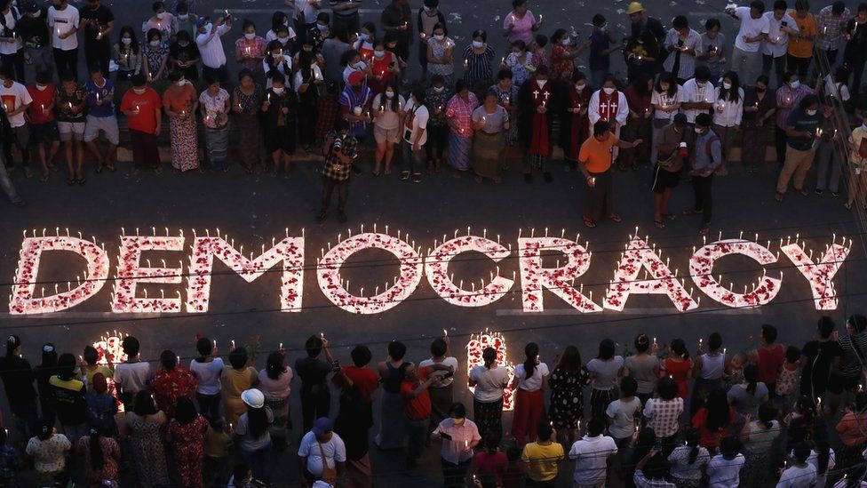 Protesters and residents hold candles and pray during a ceremony to honour protesters who have died during clashes with the military around the country, Yangon, Myanmar, 6 March 2021