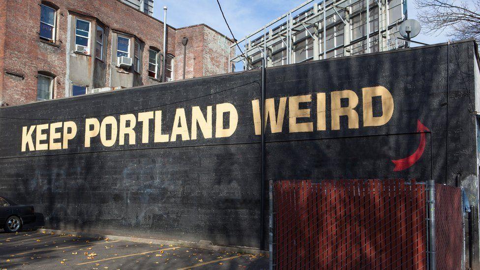 A sign saying 'Keep Portland Weird' - the city's slogan