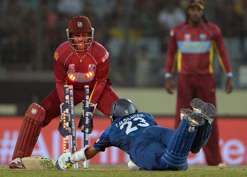Sri Lanka batsman Tillakaratne Dilshan struggles to make his ground as the bails fly off the stumps