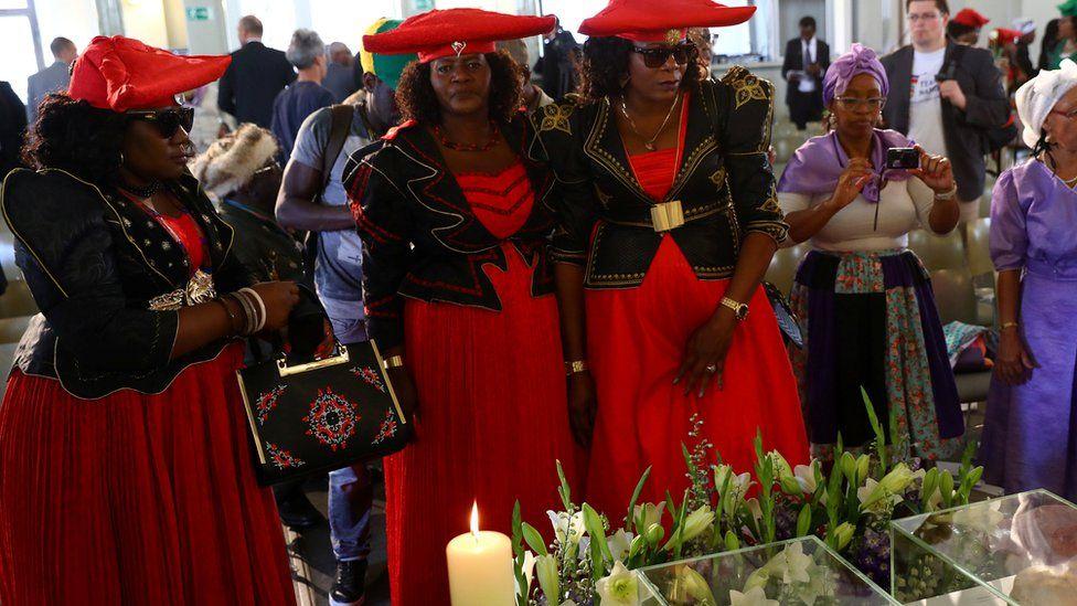 Members of a delegation attend a ceremony in Berlin, Germany, August 29, 2018, to hand back human remains from Germany to Namibia