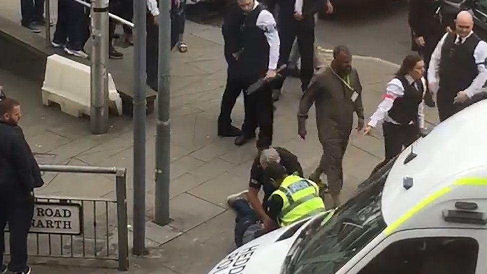 Police arresting a man in Cardiff