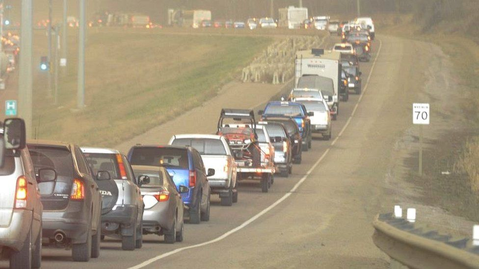 Traffic queues on a road out of Fort McMurray on 3 May 2016