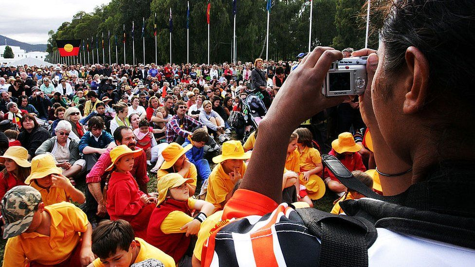 A crowd watches the apology to the Stolen Generations in 2008