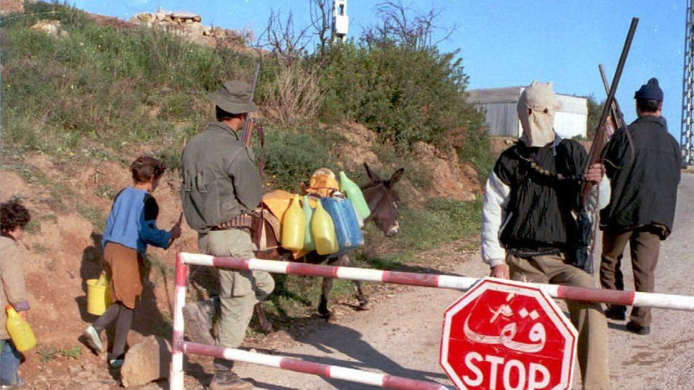 Armed villagers in Algeria