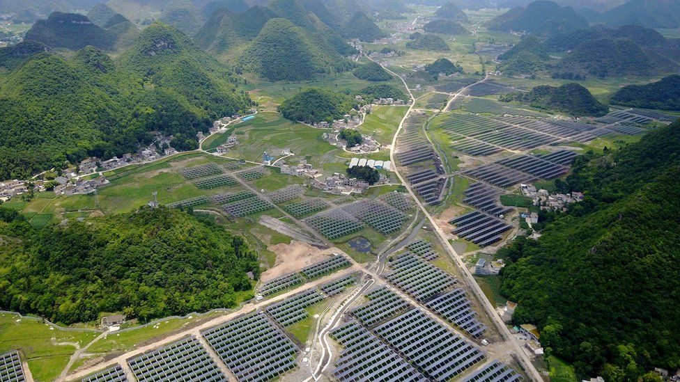 This photo taken on June 10, 2017 shows greenhouses built with solar panels on their roofs, in Yang Fang village in Anlong, in China's southwest Guizhou province.
