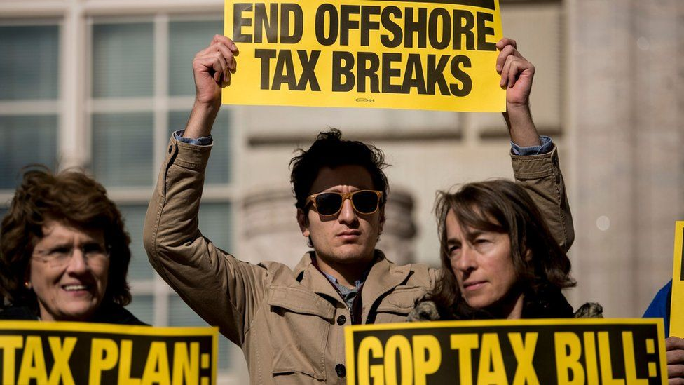 People protest the Republican tax reform plan outside the Department of Commerce on November 10, 2017 in Washington, DC