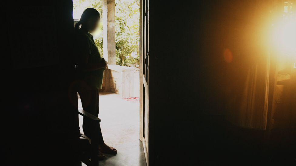 Monica in doorway