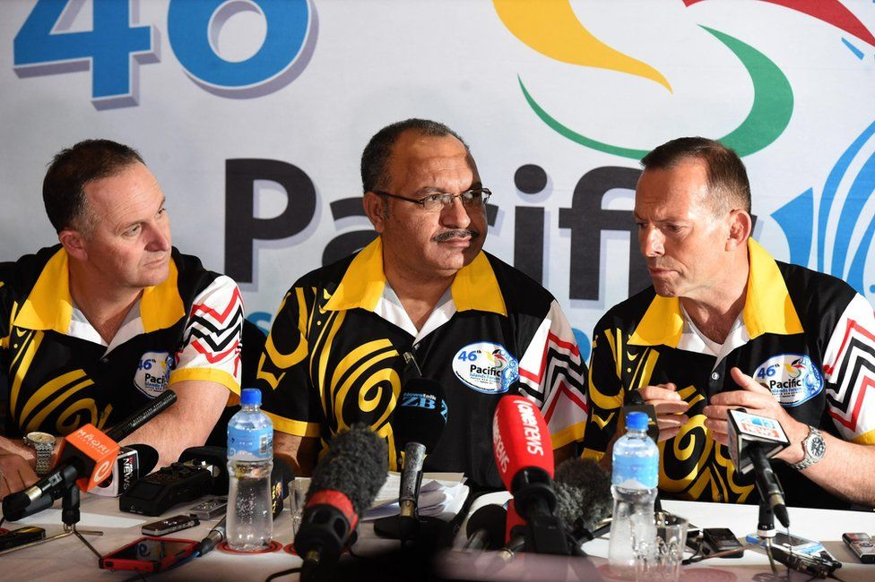 A picture made available on 11 September 2015 shows (L-R) New Zealand's Prime Minister John Key, Papua New Guinea's Prime Minister Peter O'Neill and Australia's Prime Minister Tony Abbott at a press conference after the main meeting of the Pacific Islands Forum in Port Moresby, Papua New Guinea, 10 September 2015.